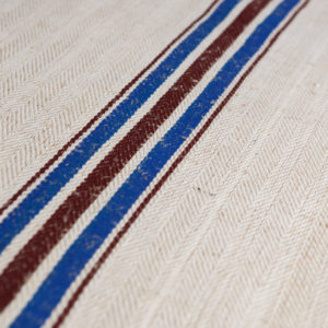 bathroom-hemp-rug-with-red-and-blue-stripes-vintage